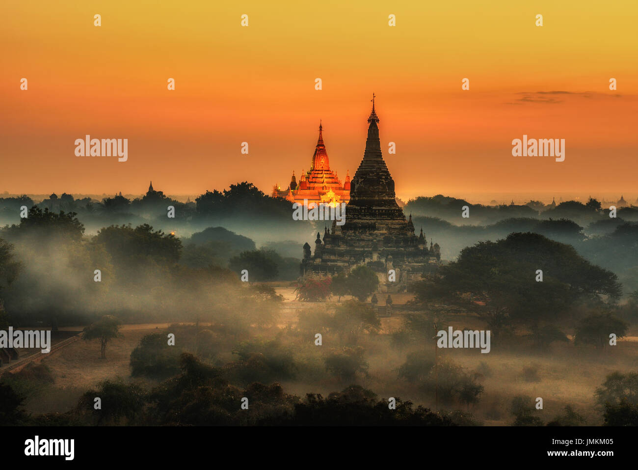 Scenic sunrise above Bagan in Myanmar. Bagan is an ancient city with thousands of historic buddhist temples and stupas. - Stock Image