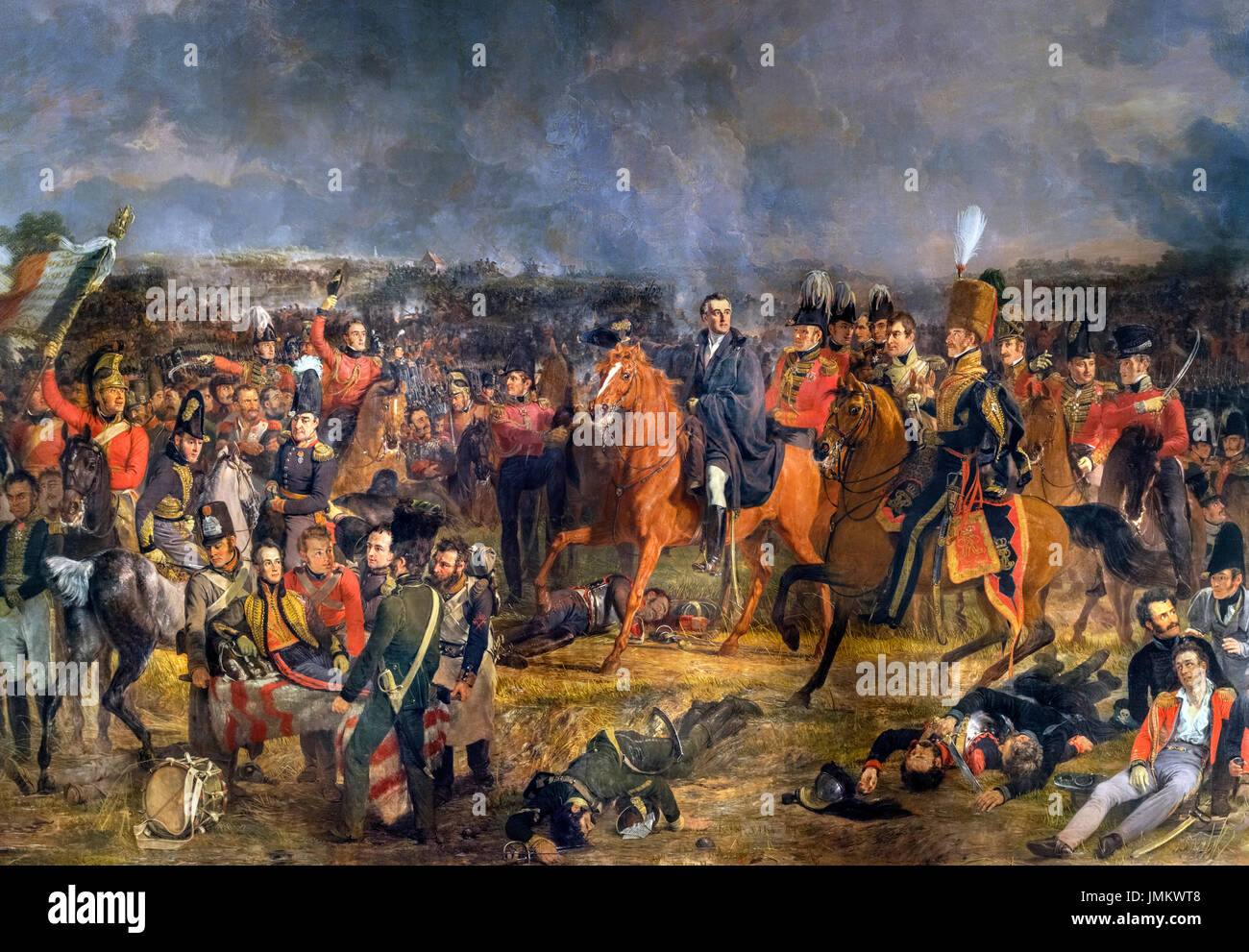 The Battle of Waterloo by Jan Willem Pieneman (1779-1853), oil on canvas, 1824. The painting shows the Duke of Wellington, on horseback in the centre of the picture, at a decisive moment in the Battle of Waterloo on 18 June 1815. William, Prince of Orange, is shown wounded on a stretcher in the foreground. - Stock Image