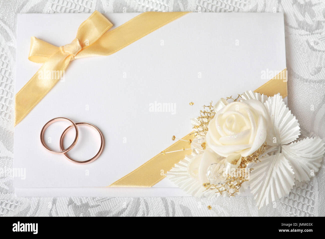 Wedding Invitation Card With Gold Rings And Satin Rose Stock