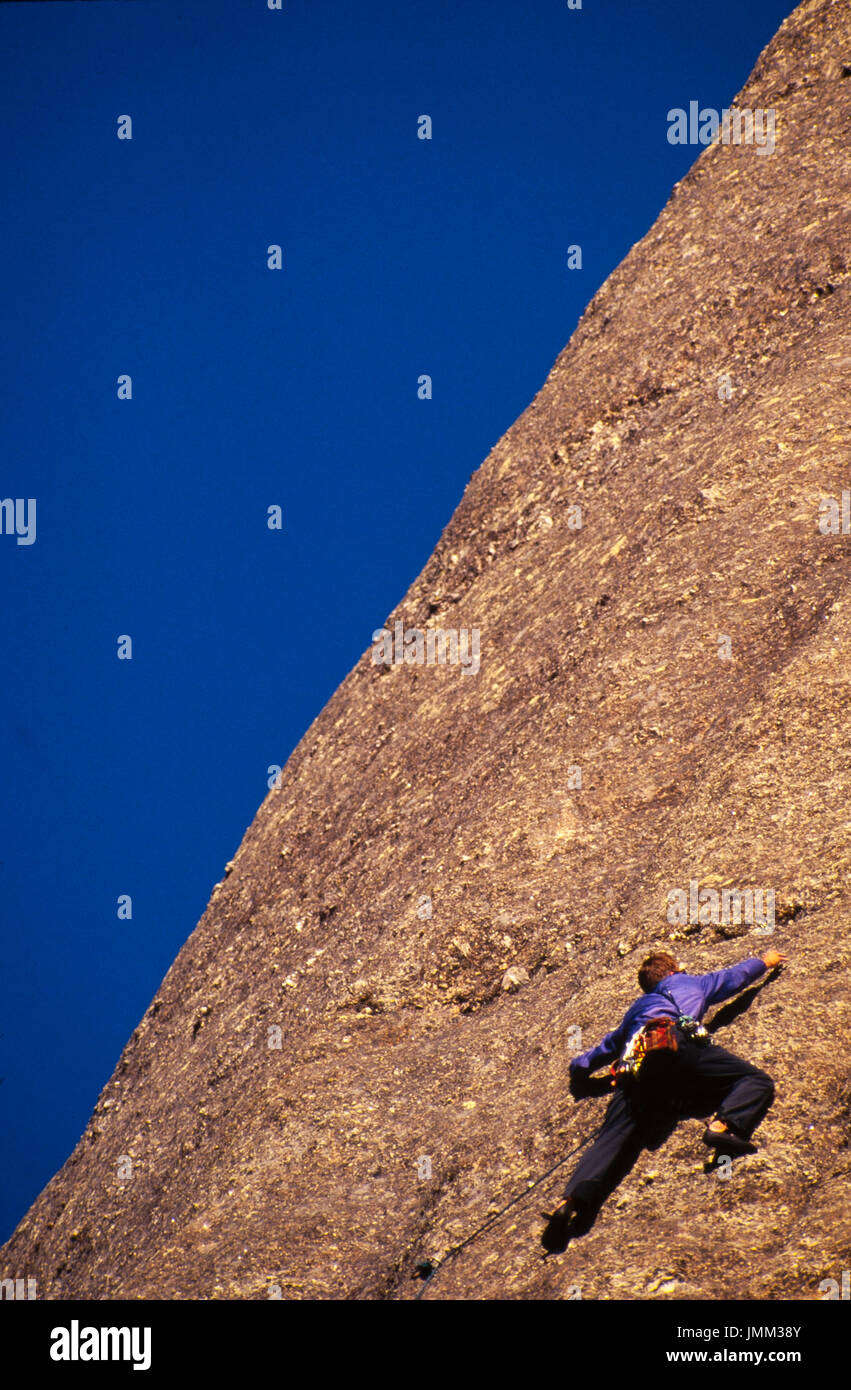 Rock climbers ascend the sheer cliffs on the backside of Mt. Rushmore, South Dakota. - Stock Image