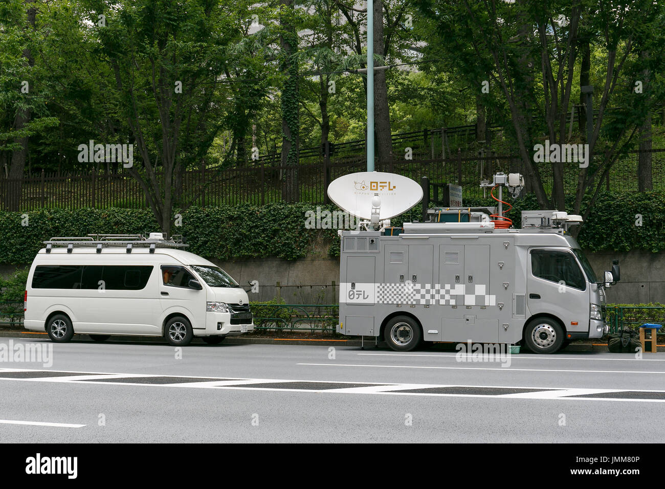 A live news TV satellite truck is seen outside the Ministry