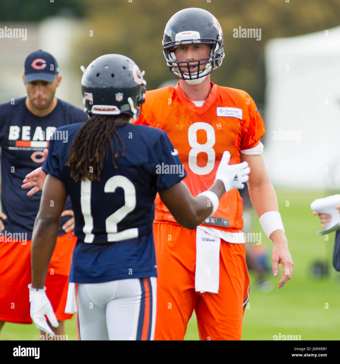 eb5fd41bd Chicago Bears Quarterback  8 Mike Glennon talks with  12 Marcus Wheaton during  training camp on the campus of Olivet Nazarene University