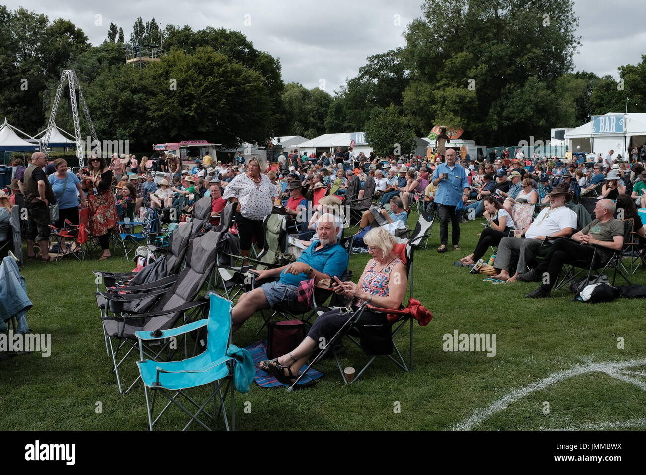 Cambridge, UK. 28th July, 2017. Day two of the Cambridge Folk Festival 2017 as crowds take to the deckchairs. Richard Etteridge / Alamy Live News - Stock Image