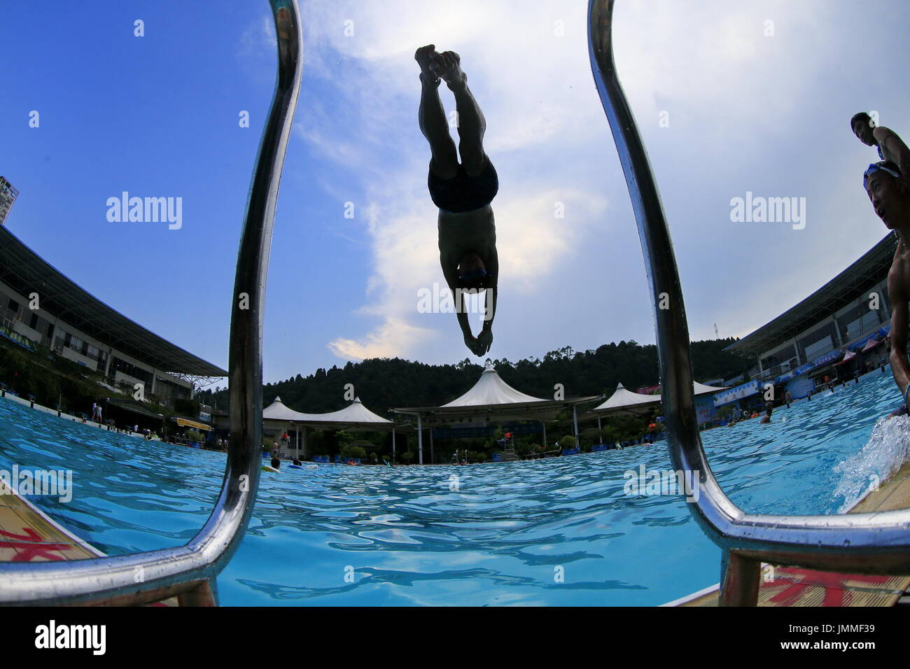 Suining, China's Sichuan Province. 28th July, 2017. People goes swimming at Chuanshan Natatorium to cool off amid hot weather in Suining, southwest China's Sichuan Province, July 28, 2017. Credit: Zhong Min/Xinhua/Alamy Live News - Stock Image