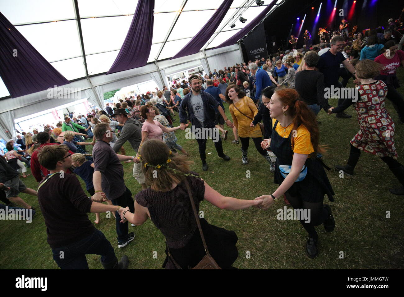 Cambridge, UK. 28th July, 2017. People attending the Cambridge Folk Festival participate in The Urban Folk Theory's Celidh. Richard Etteridge / Alamy Live News - Stock Image