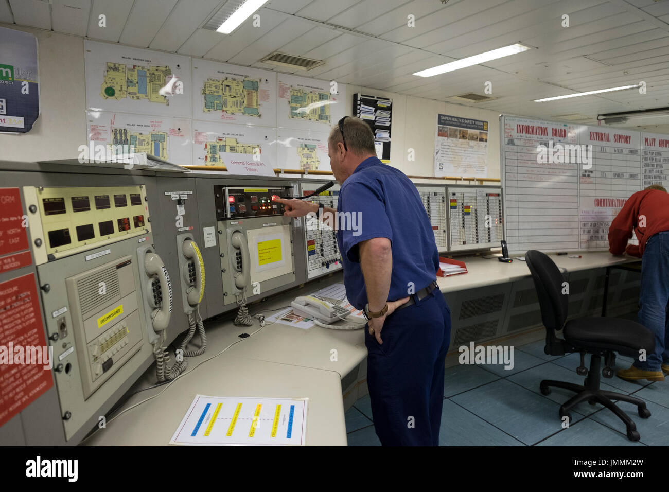 The OIM (offshore installation manger) making a public announcement, during a emergency drill. credit: LEE RAMSDEN / ALAMY - Stock Image