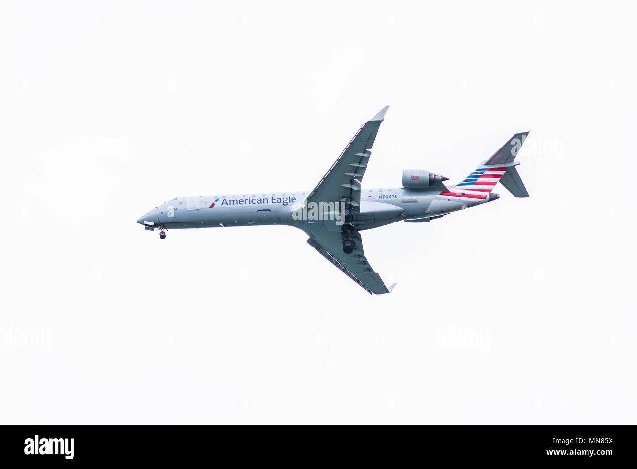 Washington DC, USA - March 17, 2017: Isolated closeup of American Eagle plane landing with cloudy sky - Stock Image
