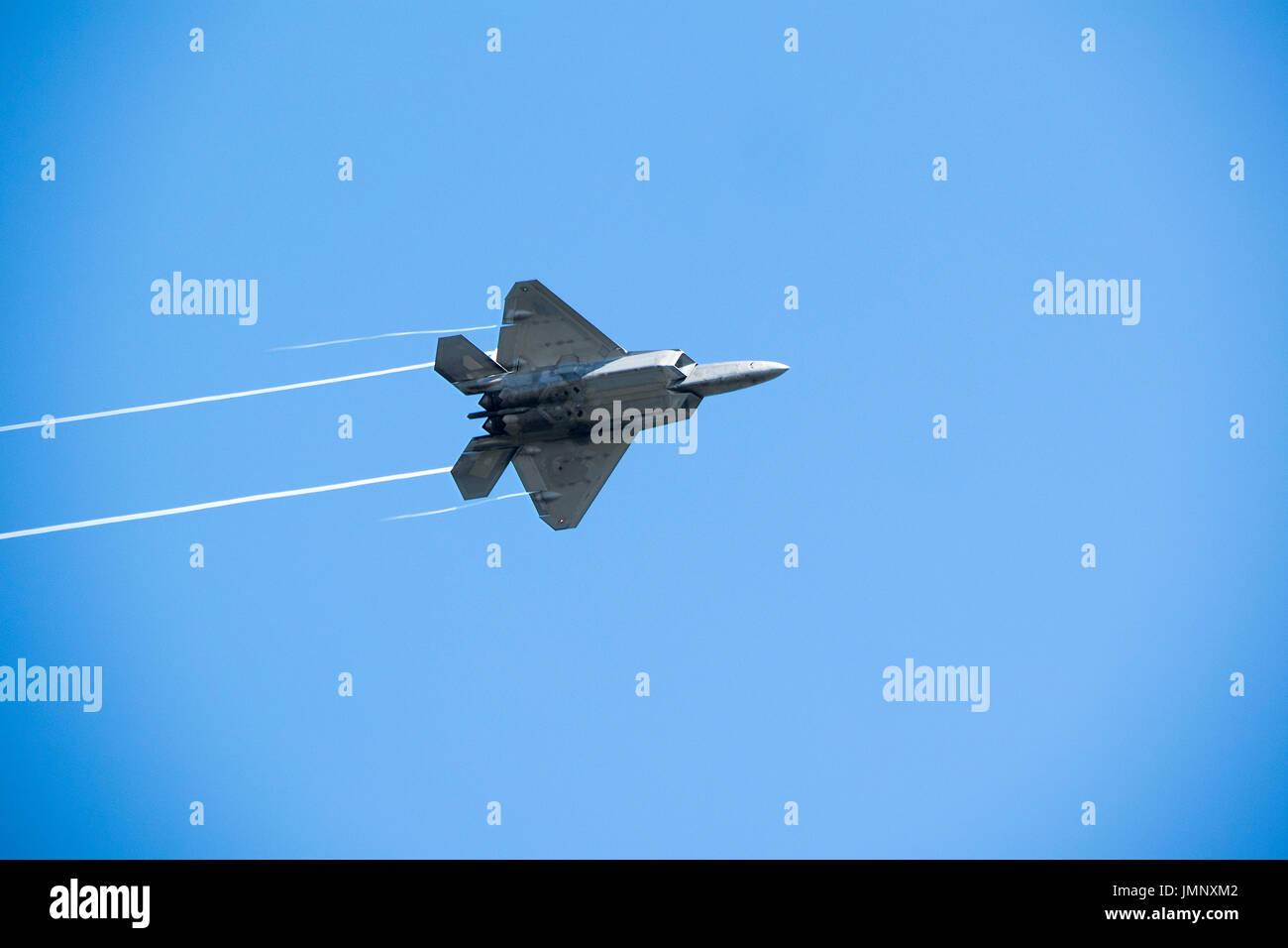 Lockheed Martin F-22 Raptor flying over Tri-Cities, Washington State, USA, before airshow. - Stock Image