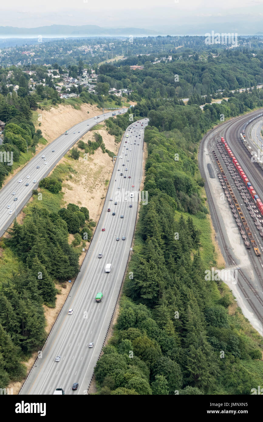 I-5 Highway and BNSF railroad tracks beside Boeing Field, Seattle, Washington State, USA - Stock Image