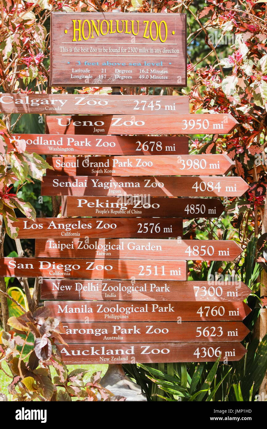 Honolulu, Hawaii - May 26, 2016: A sign post at Honolulu Zoo giving distances in miles to other international zoos. - Stock Image