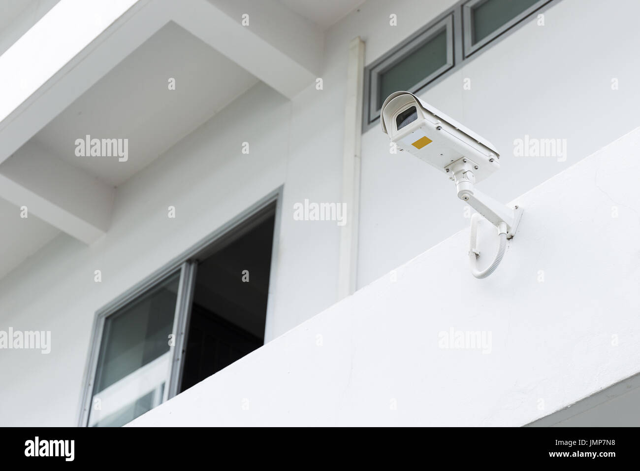 CCTV camera on white building for security - Stock Image