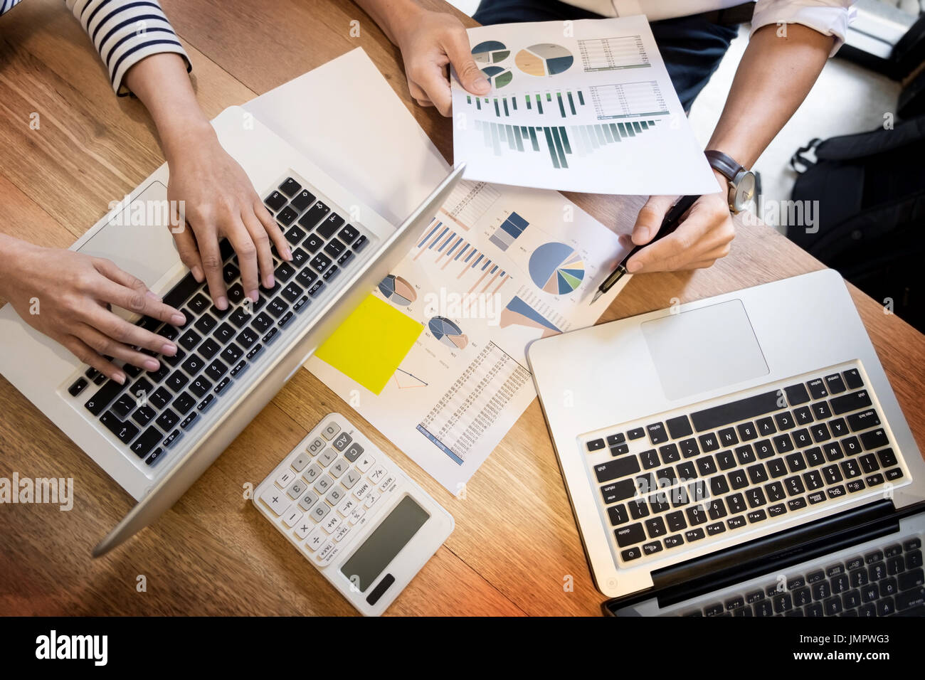 Creative Team job. young business man working with startup project analyse graph plans and discuss at  workspace office, Brainstorm meeting concept - Stock Image
