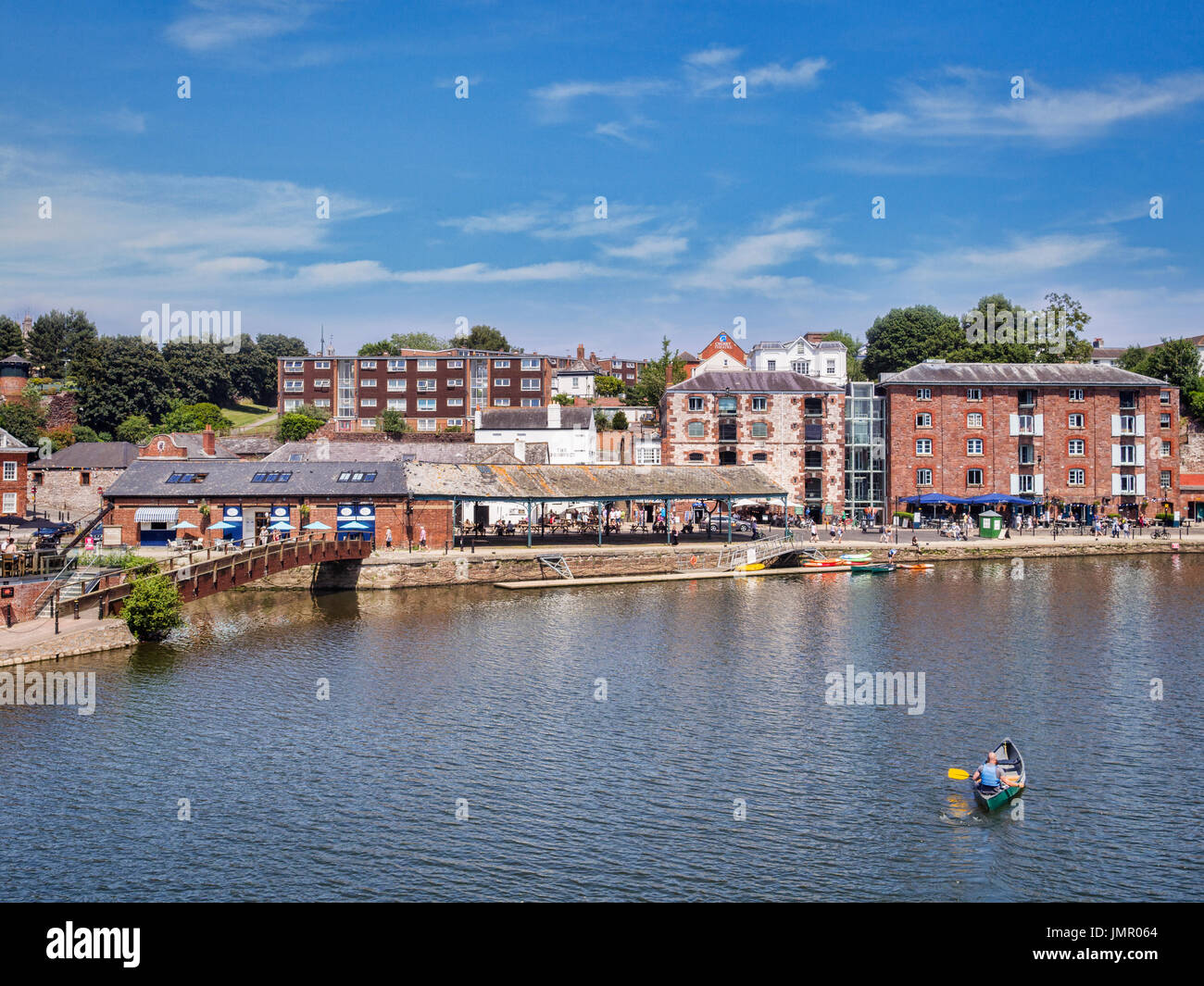 21 June 2017: Exeter, Devon, England, UK - A view across the River Exe to some of the attractions on Exeter Quays. - Stock Image