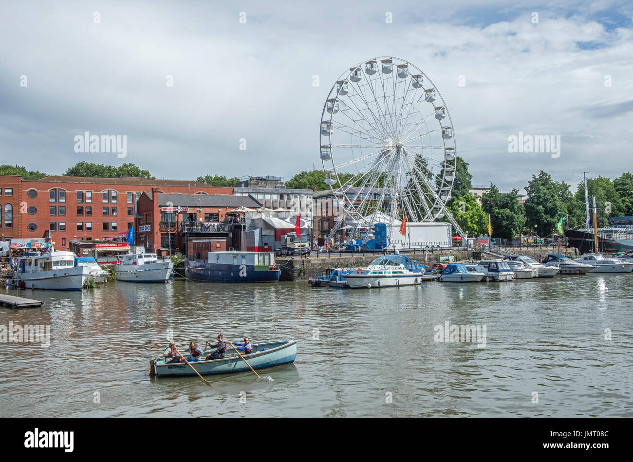 Rowing Boat and Ferris Wheel Bristol Harbour - Stock Image