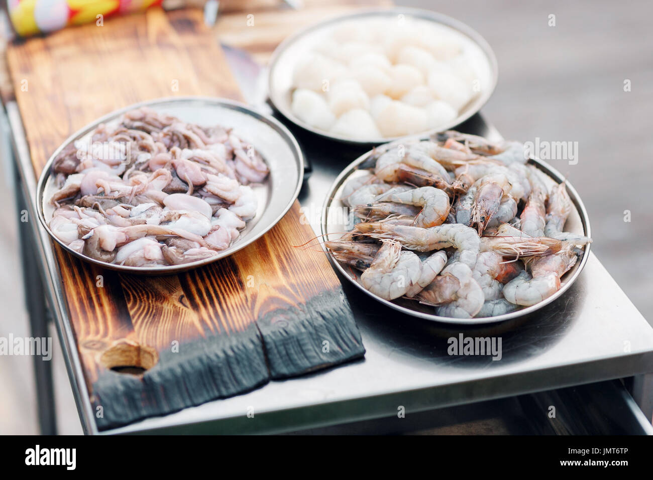 Fresh raw seafood. On metal table - Stock Image