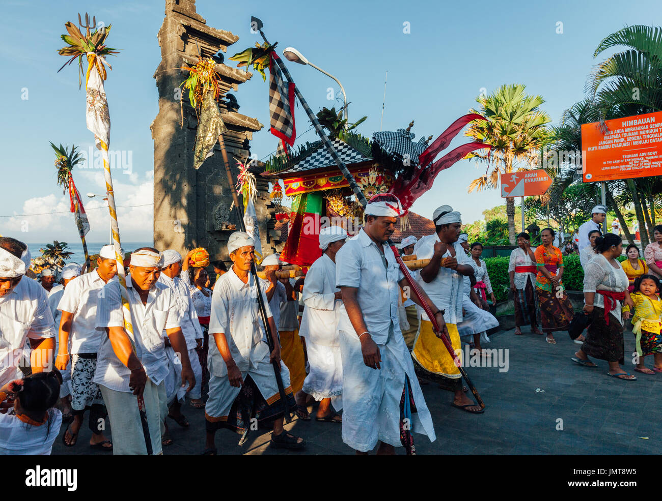 Bali, Indonesia - March 07, 2016: Balinese people in traditional clothes carry jempana or wooden litter at the processionStock Photo