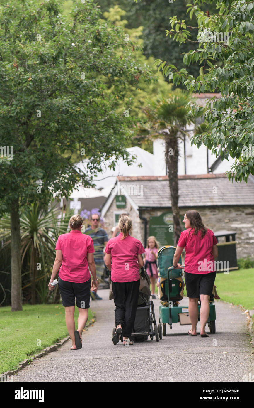Nursery workers walking around Trenance Gardens in Newquay, Cornwall. - Stock Image