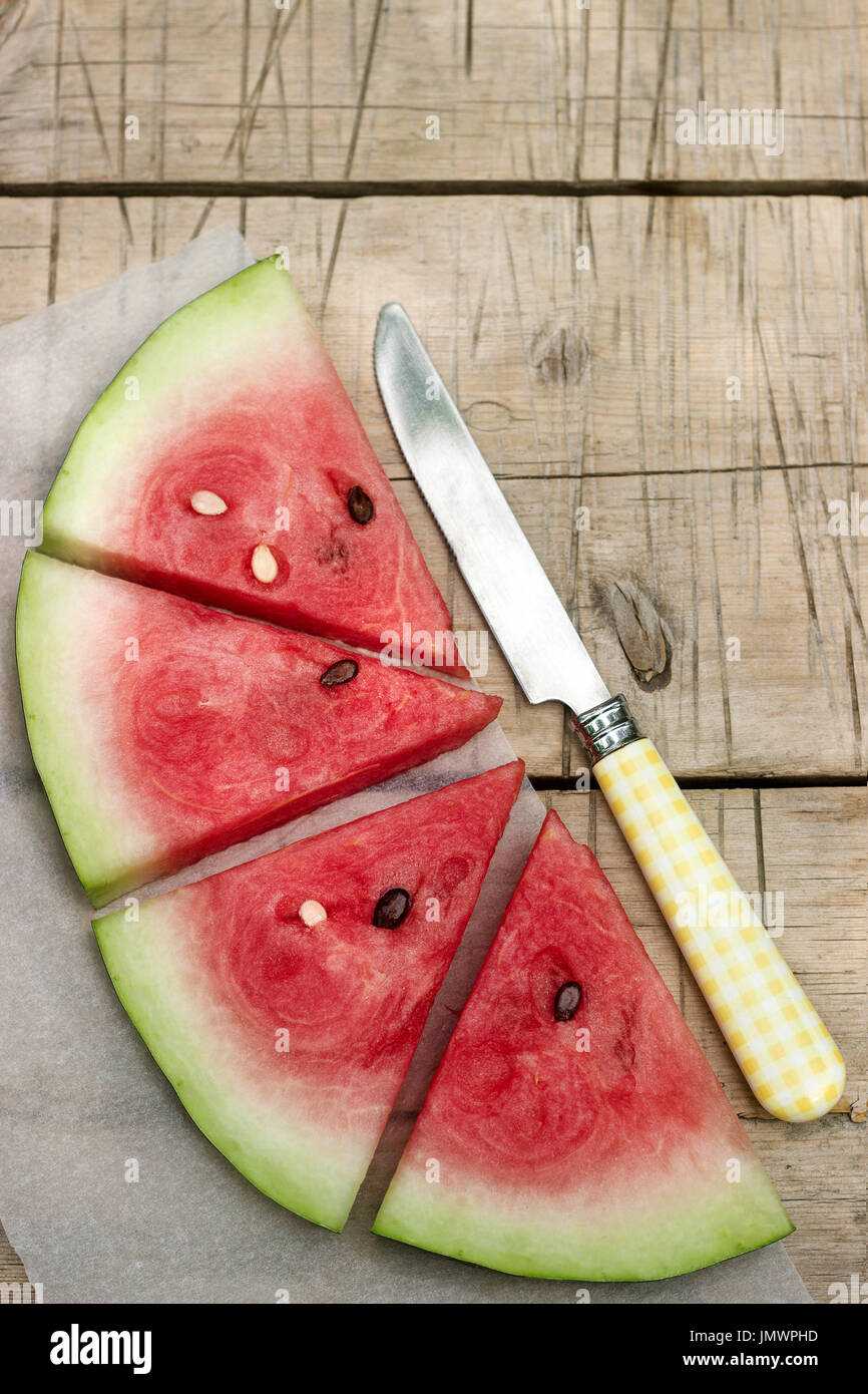 Watermelon slices on a wooden table Stock Photo
