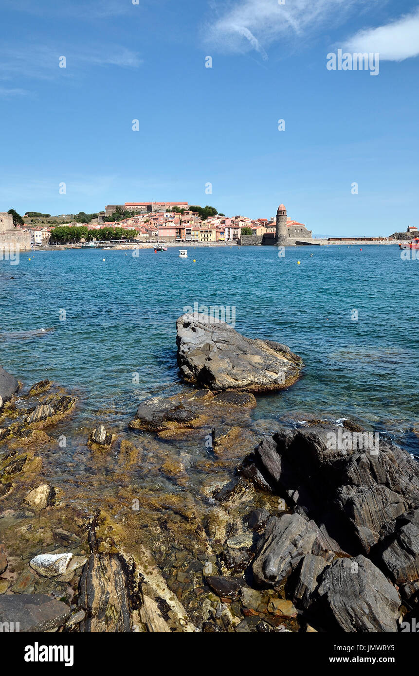 Coast of Collioure with the town and the fortifications in the background, commune on the côte vermeille in the Pyrénées-Orientales department, France - Stock Image