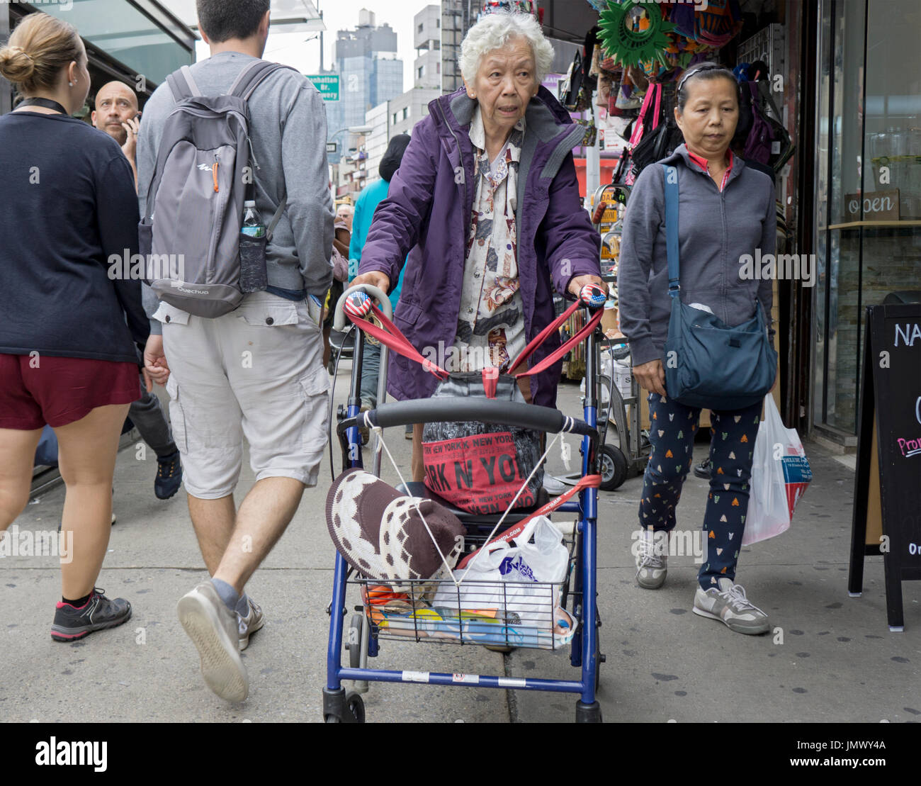 ae3b276a0 An older Chinese American woman outside shopping on a summer day on Canal  Street in Chinatown, Lower Manhattan, New York City