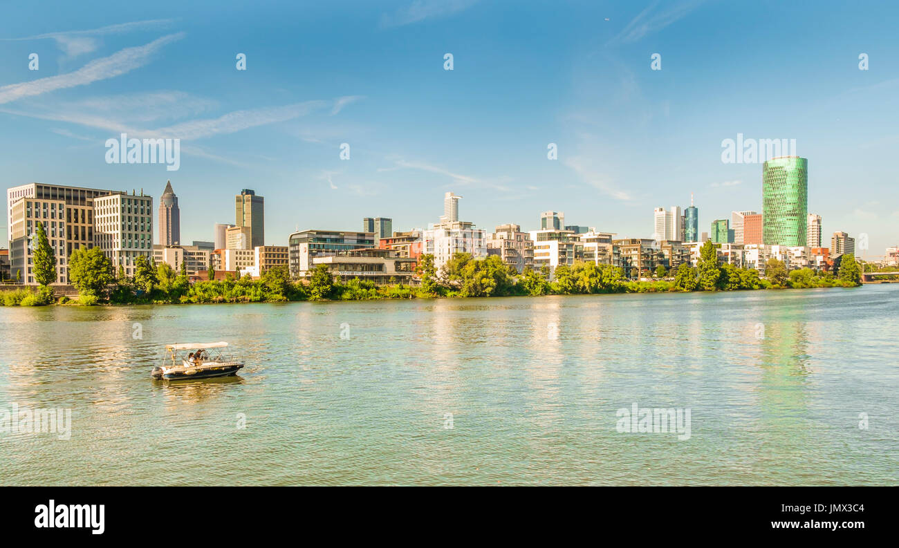 panoramic view of frankfurt skyline, pleasure boat in foreground,as seen from the south bank of river main, frankfurt Stock Photo