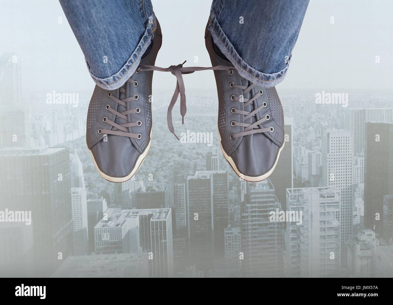 Digital composite of Shoelaces tied together over city - Stock Image