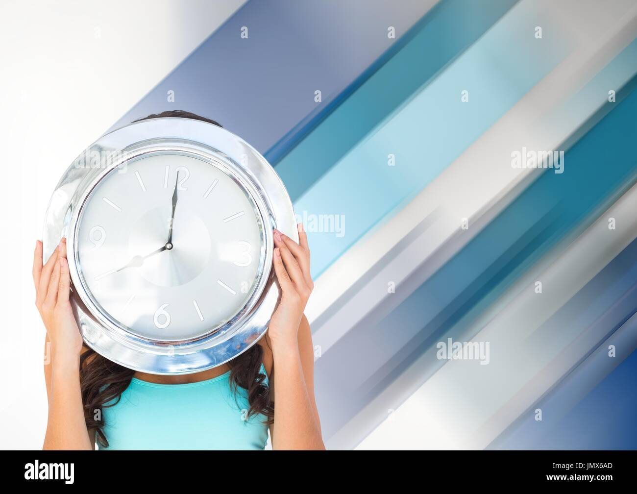 Digital composite of Woman holding clock in front of diagonal stripes effect Stock Photo