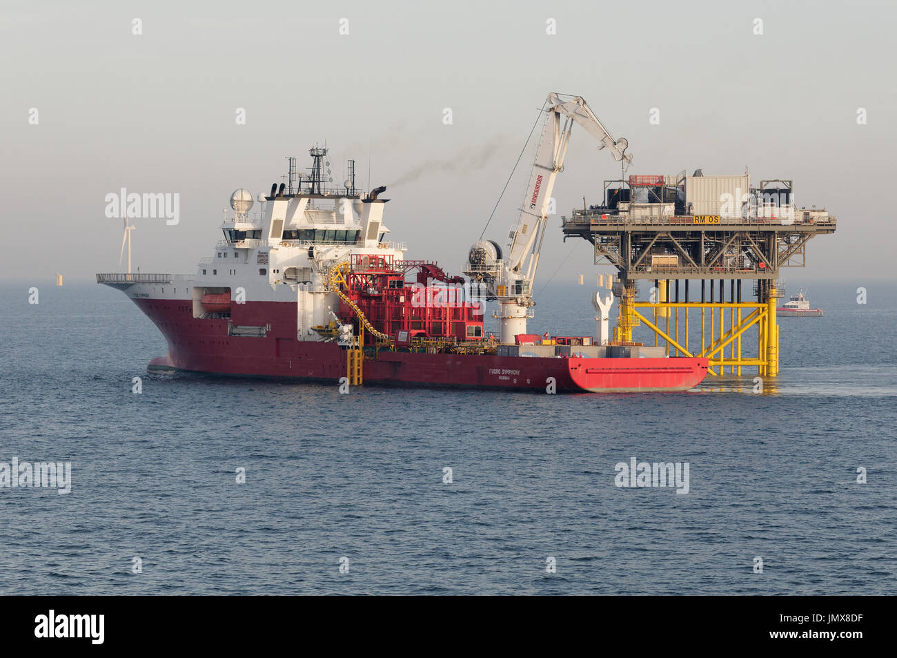 The Fugro Symphony construction vessel installing submarine export cables at the Rampion Offshore Windfarm, England. - Stock Image