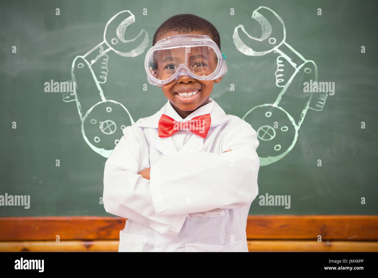 Illustrative image of hand tool against chemistry pupil smiling at camera with arms crossed - Stock Image