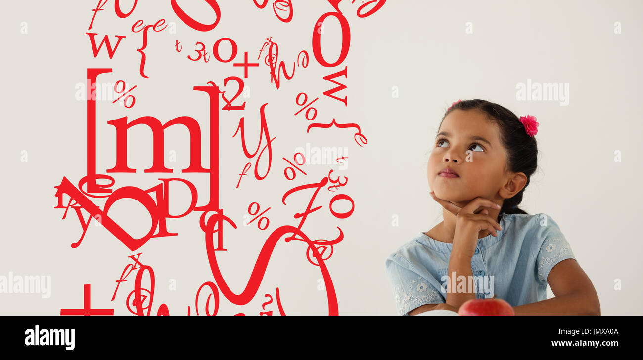 letter and number jumble against thoughtful young girl sitting - Stock Image