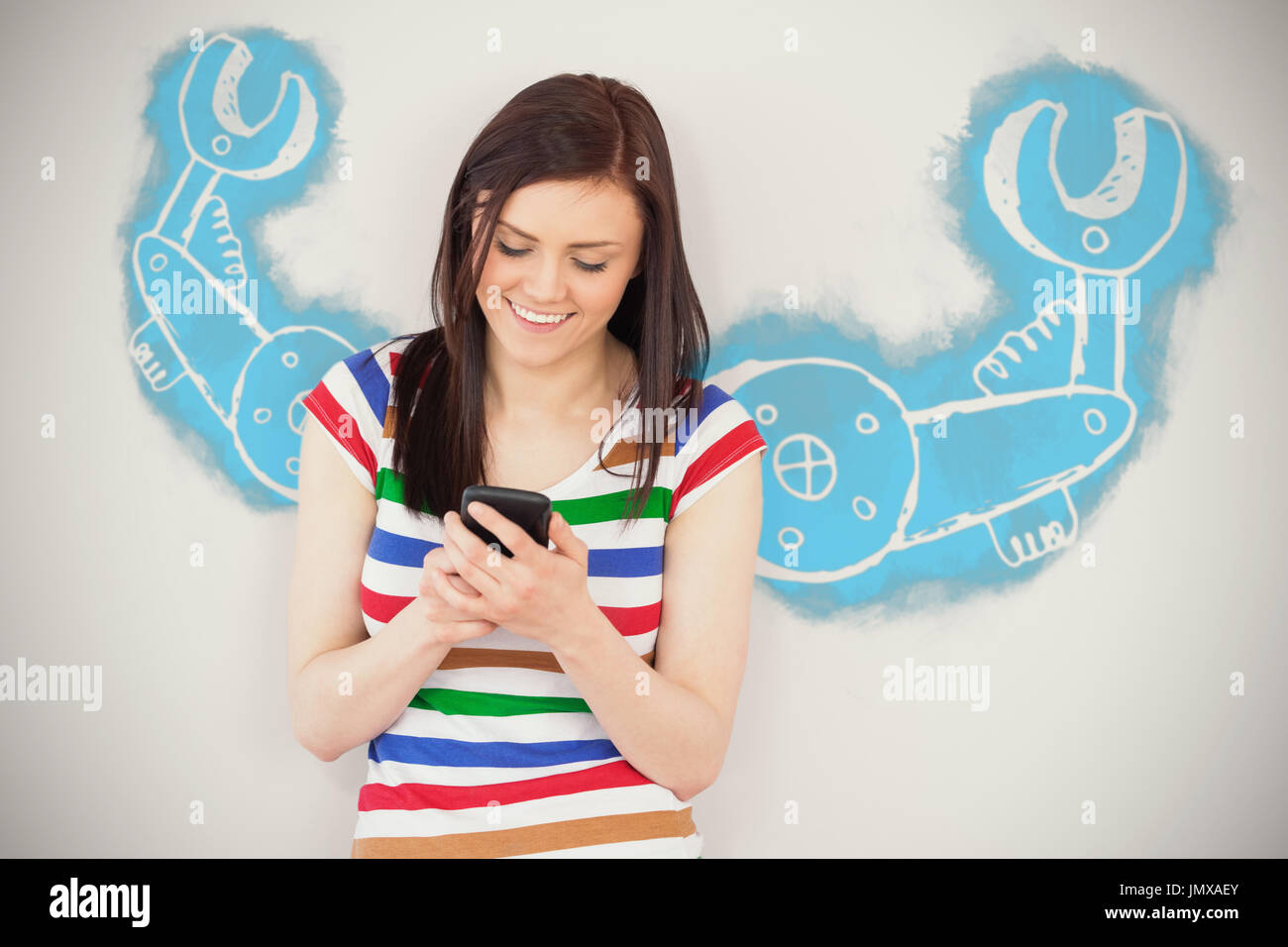 Work tool against white background against smiling girl using her mobile phone - Stock Image
