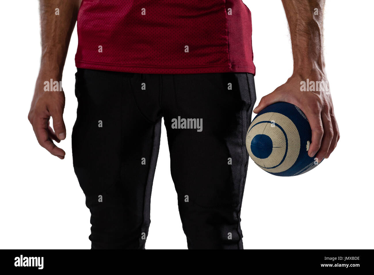 Midsection of sportsperson holding ball against white background Stock Photo