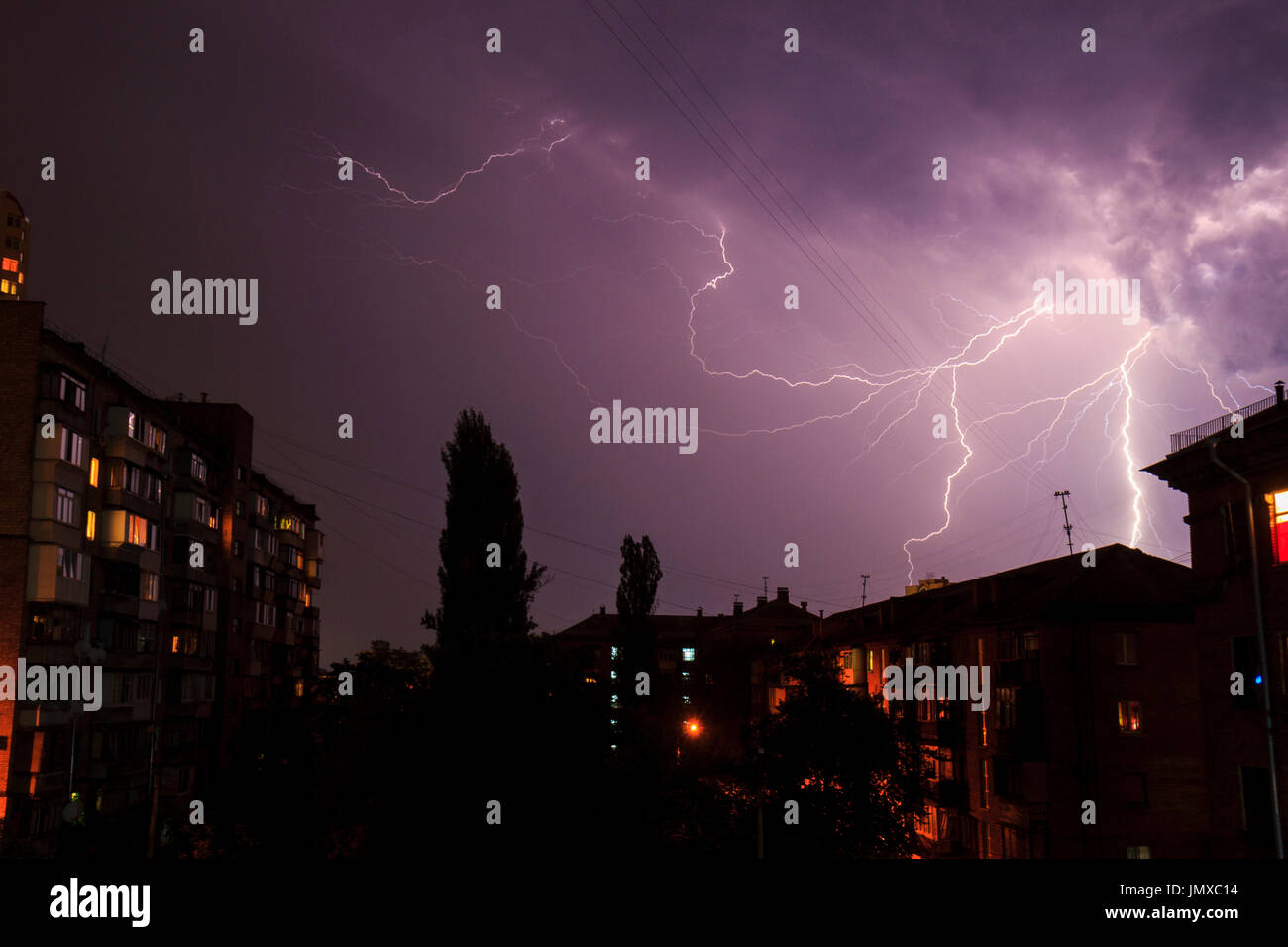 Lightning over the houses , city Creative photos - Stock Image