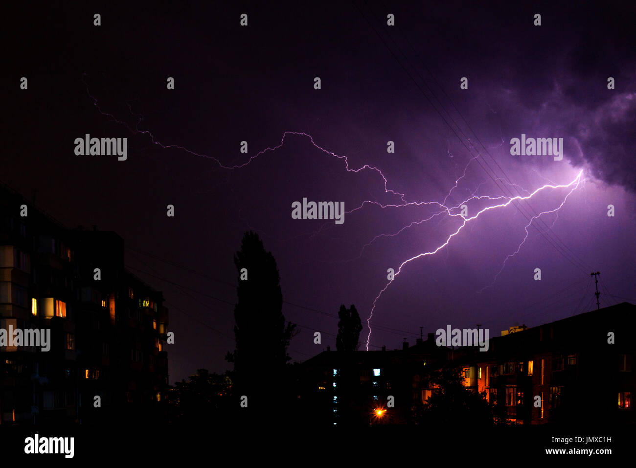 lightning over the city was broken by the sky,city - Stock Image