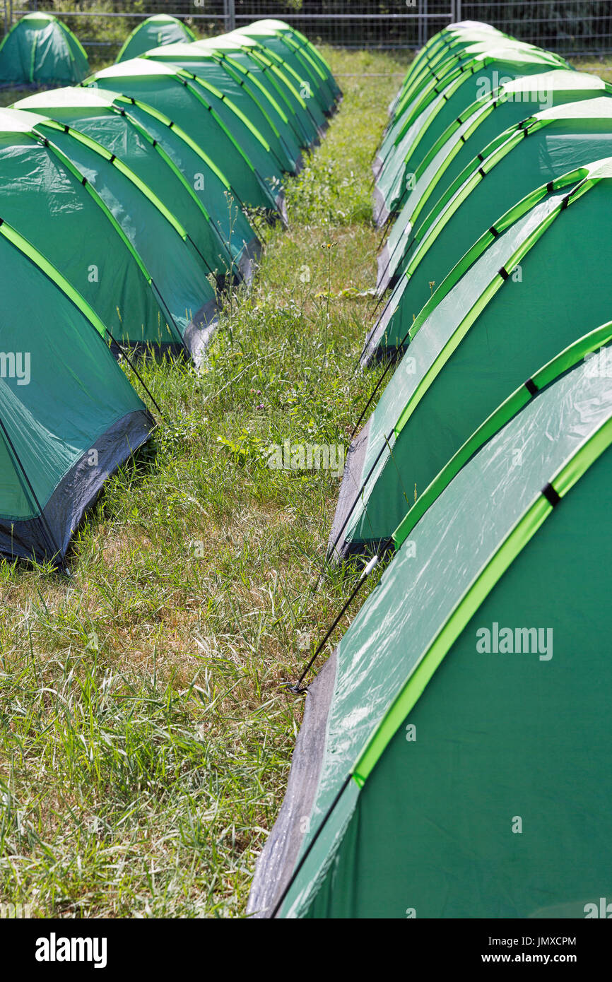 Rows of new green c&ing tents on c&ground. & Rows of new green camping tents on campground Stock Photo: 150556860 ...