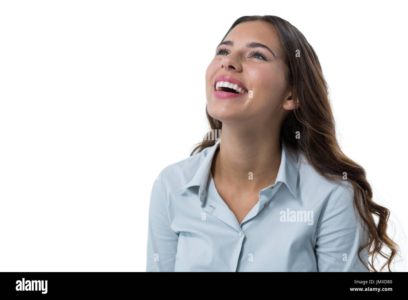 Beautiful female executive smiling against white background Stock Photo