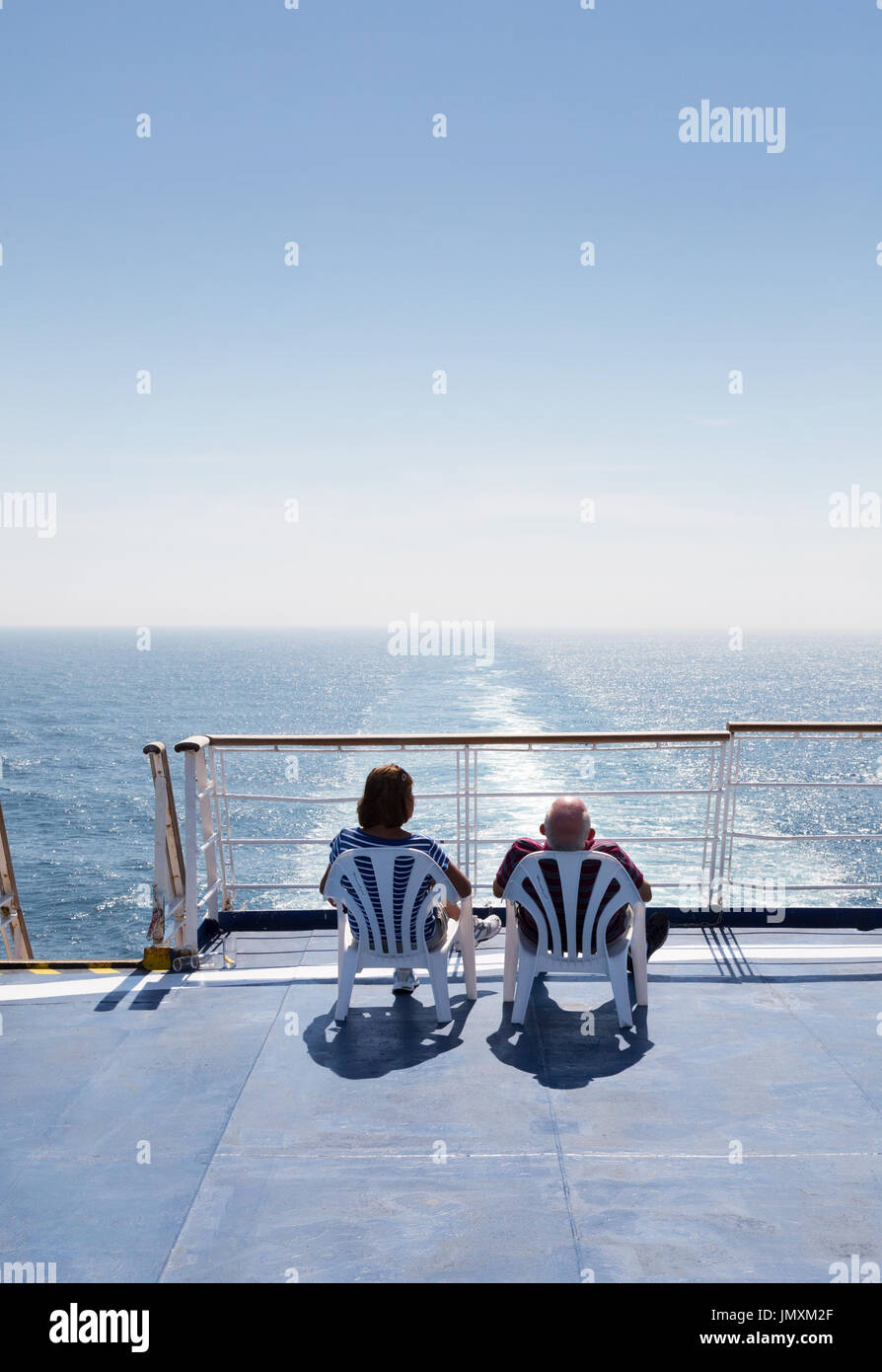 Couple cruising on a cross channel  ferry,  Brittany Ferry 'Bretagne', Brittany Ferries, from Portsmouth UK to St Malo France, Europe - Stock Image