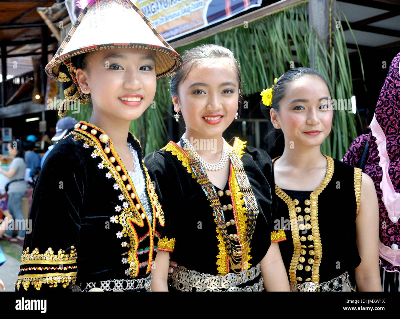 KOTA KINABALU, MALAYSIA - MAY 30, 2015: Young girls from Kadazandusun tribe in their traditional costume during the Sabah State Harvest festival celeb - Stock Image