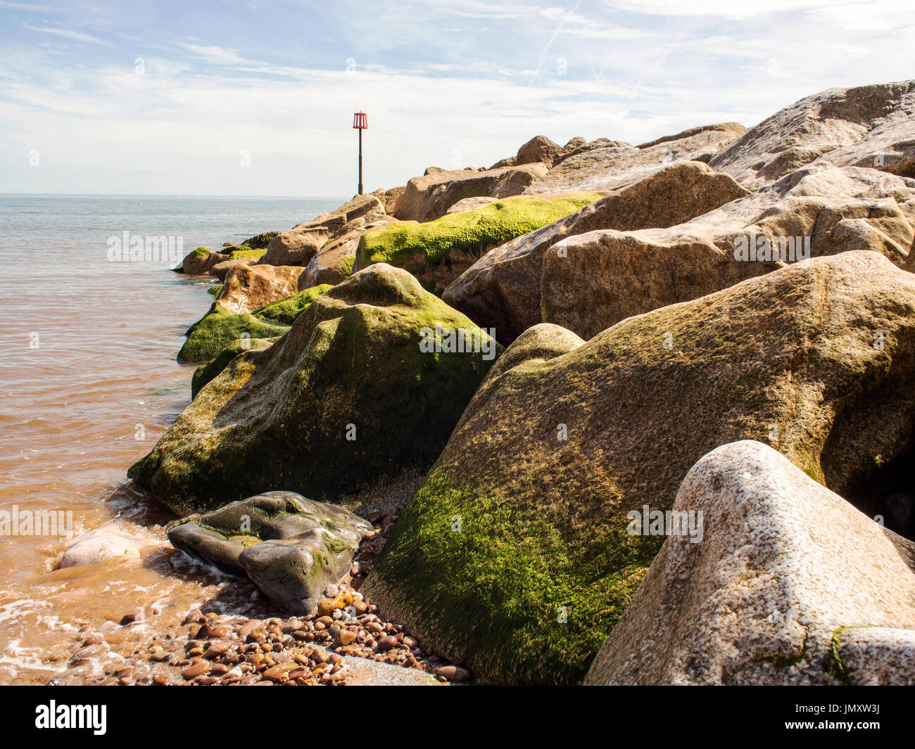 Rock armour groyne protecting the beach at Sidmouth, Devon Stock Photo