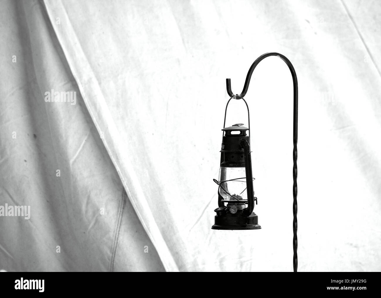 Black and white, old, civil war times gas lantern hanging at the entrance of a civil war reenactment Shelter Tent in Duncans Mills, California, USA - Stock Image