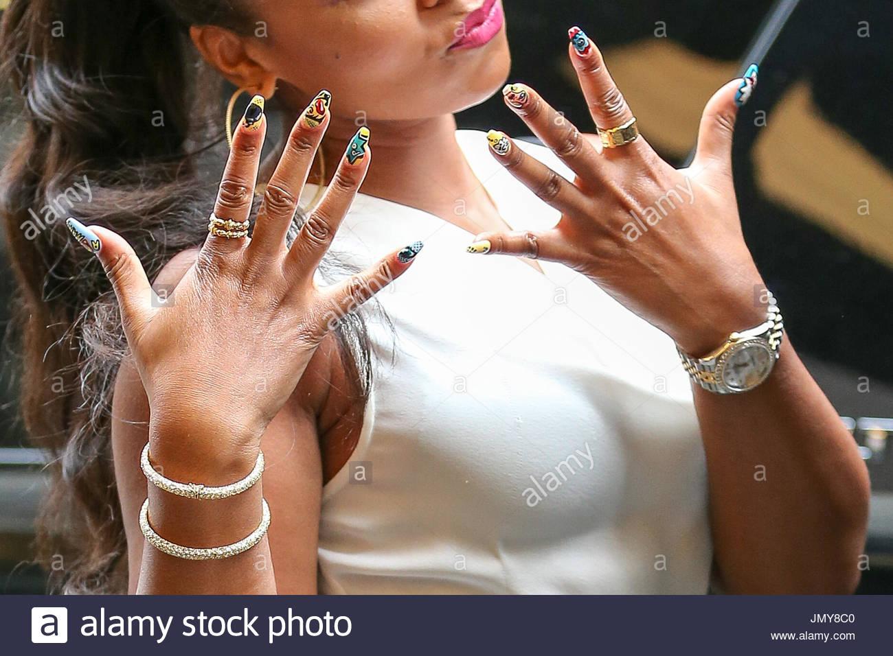 Ashanti ( Art Nails Details ). Singer Ashanti shows off her pop art ...