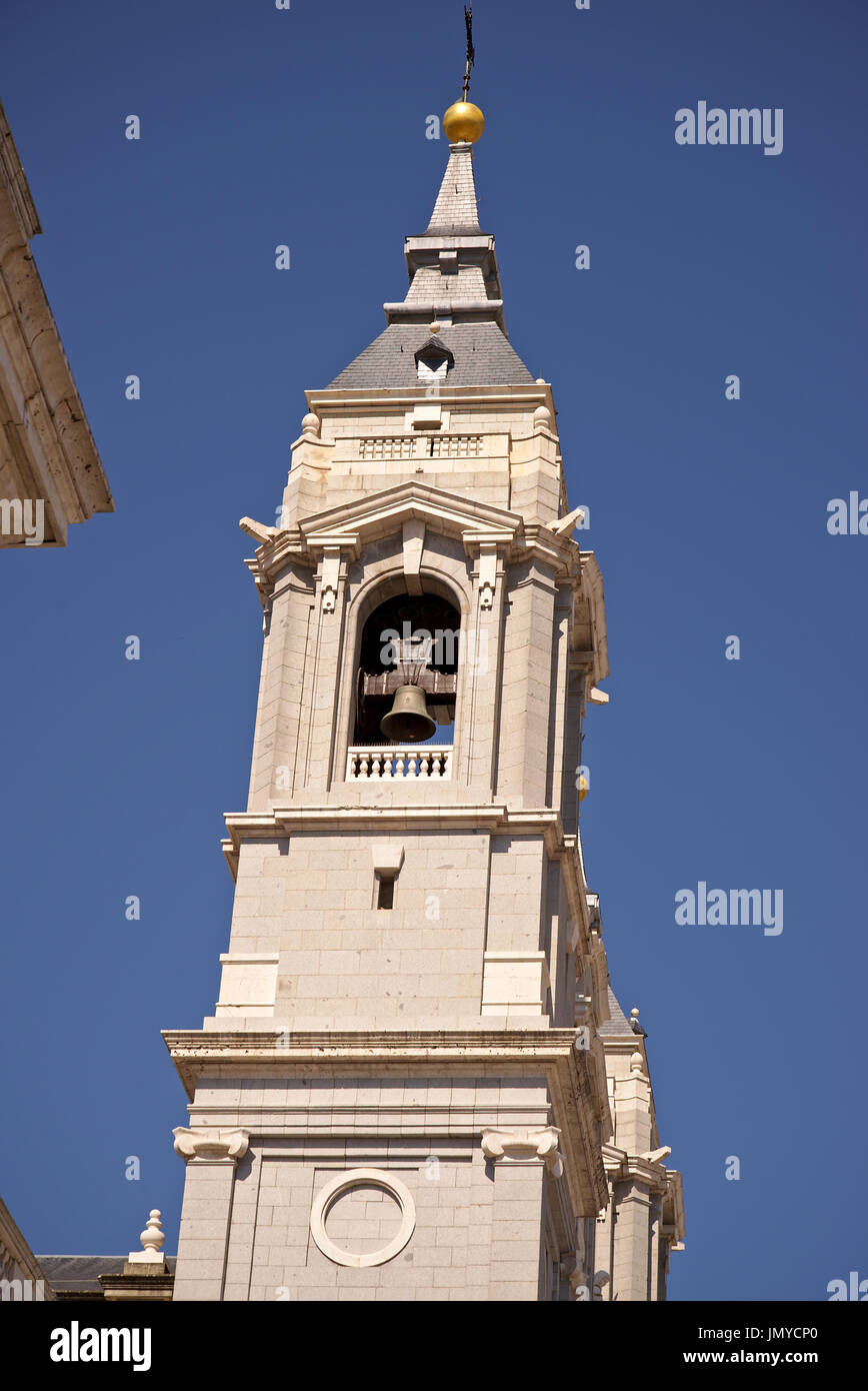 One of the main towers of 'La Almudena' cathedral, main cathedral of Madrid, Spain. With blue unclouded sky as background. - Stock Image