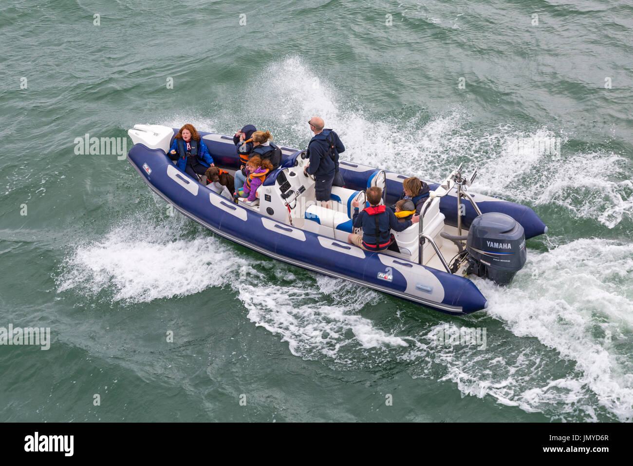 Families and dog in Avon inflatable boat boating in the