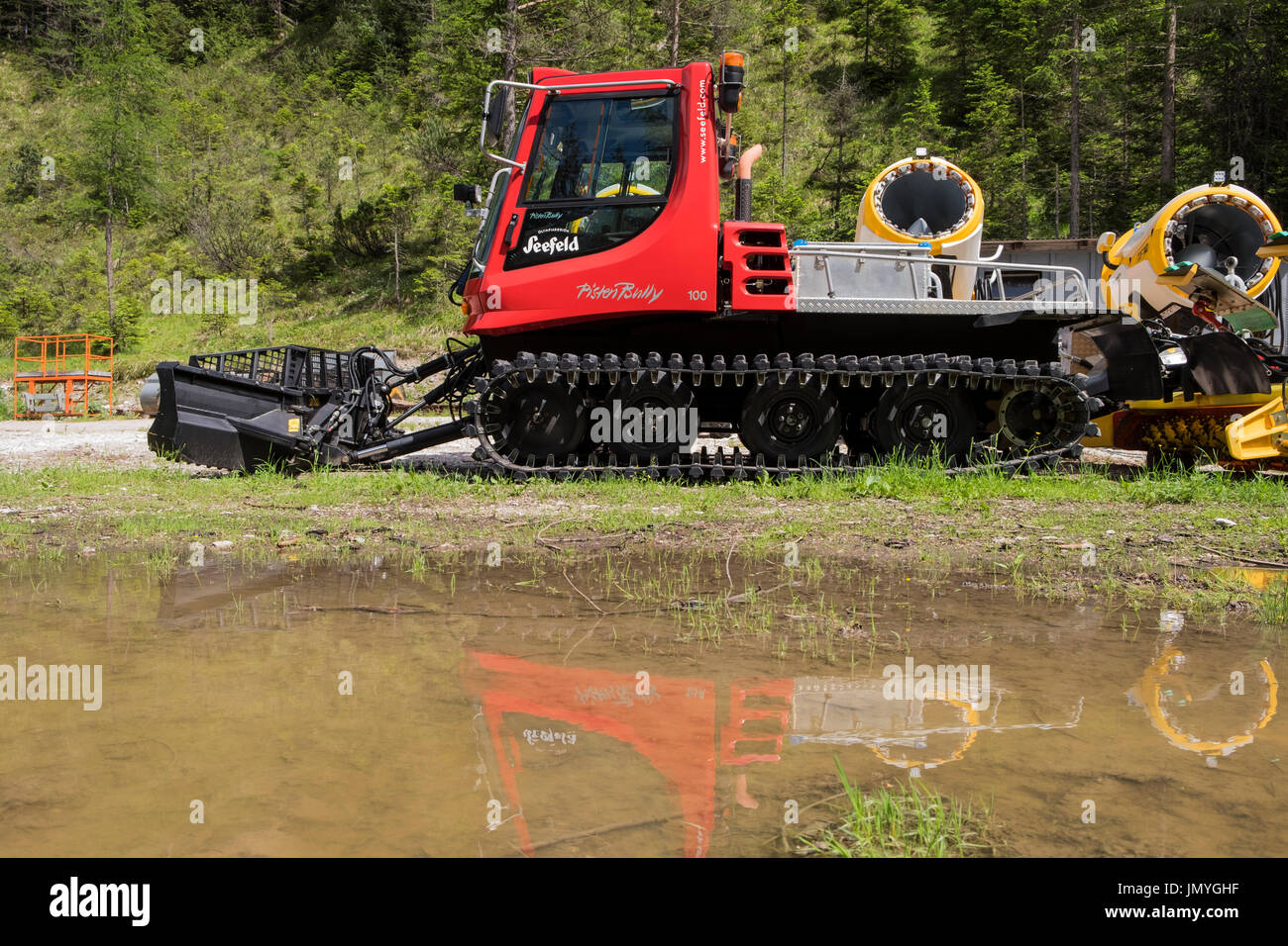 Tracked snowmobile Pisten Billy parked up for the summer in Weidach, Leutasch valley, Tyrol, Austria - Stock Image