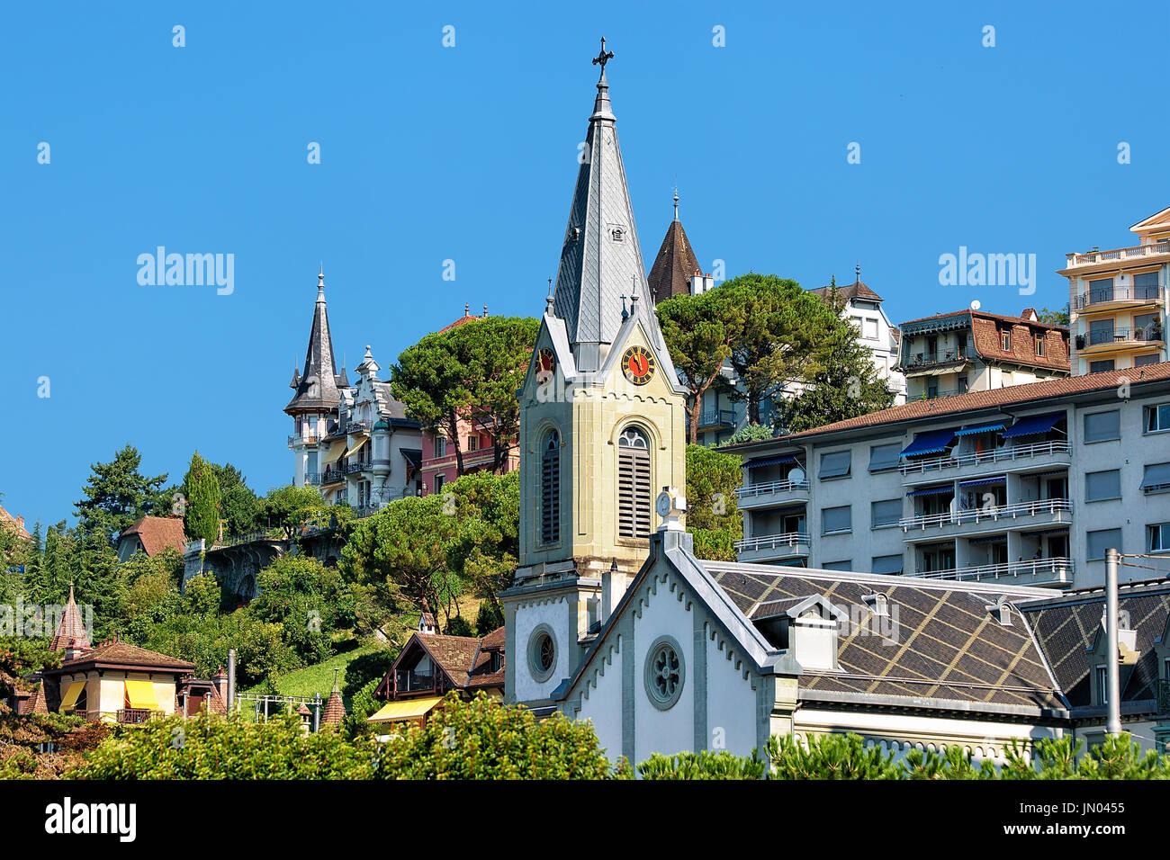 Church clock tower at Geneva Lake in Montreux, Swiss Riviera - Stock Image