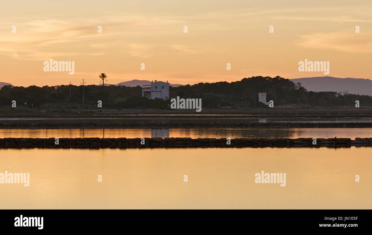 Panoramic view of the salines at dusk at Ses Salines Natural Park (Formentera, Balearic Islands, Spain) - Stock Image