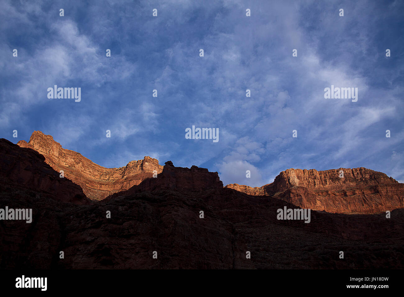 Flagstaff, Arizona, USA. 25th July, 2017. July 24, 2017.The sun sets turning the high cliffs of Toroweap and Kaibab Limestone an even redder shade. A group of river runners set off from Lee's Ferry Arizona on a 221 mile decent of the Colorado River thru the geological time exposed thru erosion in Grand Canyon National Park to Diamond Creek on the Hualapi Native American Reservation on the western edge of the park. Credit: Ralph Lauer/ZUMA Wire/Alamy Live News - Stock Image