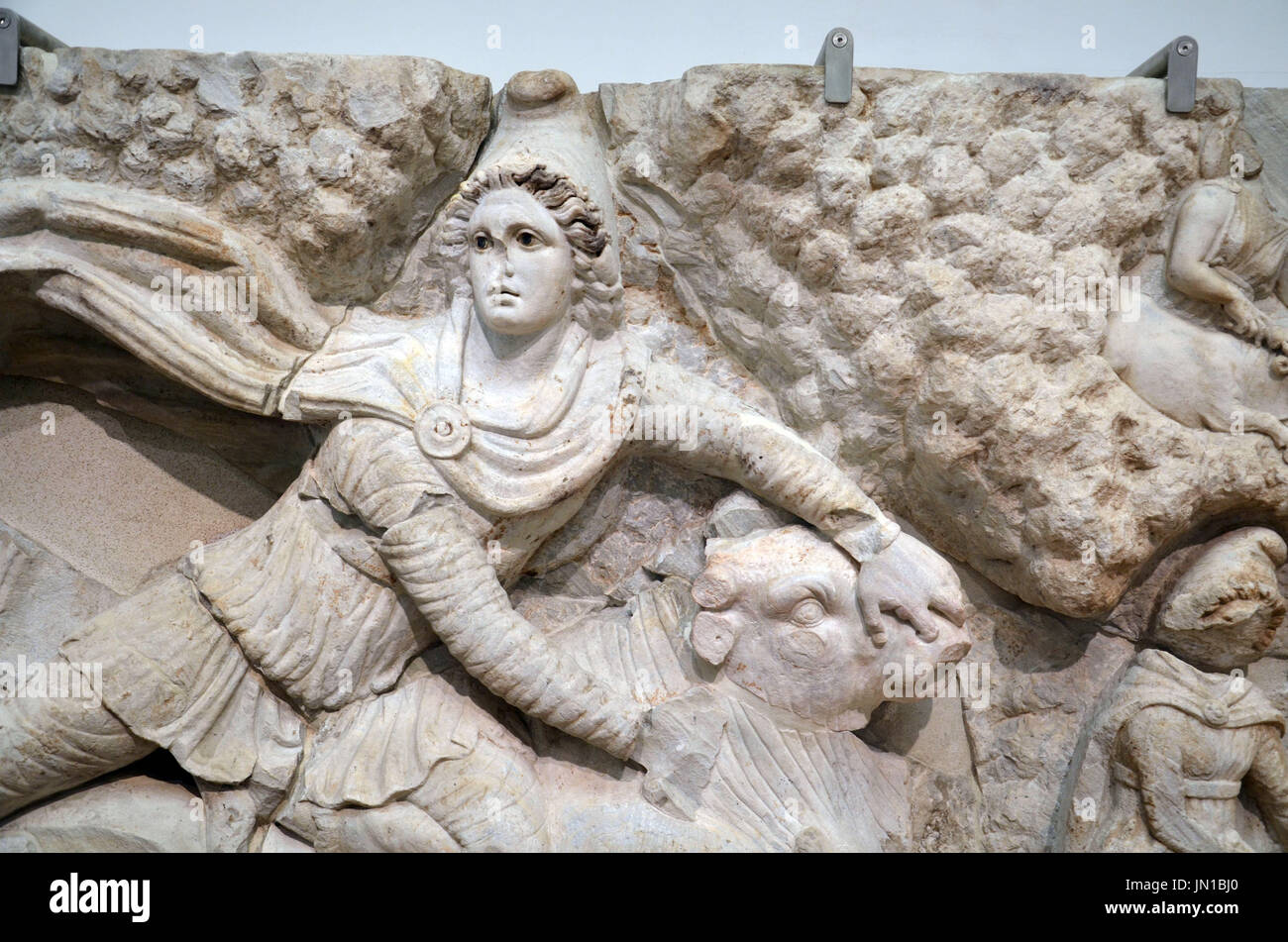Rome, Italy. 13th July, 2017. HANDOUT - A fragment of the Mithras relief, which has been lost until recently, is presented in Rome, Italy, 13 July 2017. Italian investigators have found the central piece of the precious relief, which is currently owned by the State Museum Karlsruhe, in Sardinia. It is currently on a ten year loan to the city of Rome. (ATTENTION EDITORS: EDITORIAL USE ONLY IN CONNECTION WITH CURRENT REPORTING/MANDATORY CREDIT: 'Rosario Ansalone/Badisches Landesmuseum/dpa') Photo: Rosario Ansalone/Badisches Landesmuseum/dpa/Alamy Live News - Stock Image