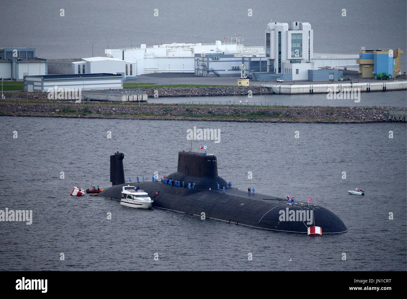 St Petersburg, Russia. 28th July, 2017. Russian Navy's TK-208 Dmitry Donskoy nuclear submarine arrives at the Leningrad Naval Base of the Russian Baltic Fleet in the town of Kronstad on Kotlin Island to participate in the Main Navy Parade scheduled for July 30, 2017 to mark Russian Navy Day. Credit: Peter Kovalev/TASS/Alamy Live News - Stock Image