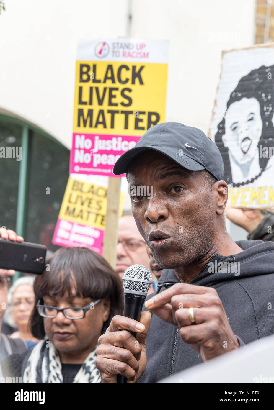 London, UK. 29th July, 2017. Vigil and protest for Rashan Charles outside Stoke Newington Police Station. The fathers of Rashan Charles and Edson da Costs and MP Diane Abbott attended. Representative of Charles Rashan's family, Stafford Scott speaks. Credit Carol Moir/Alamy Live News. - Stock Image